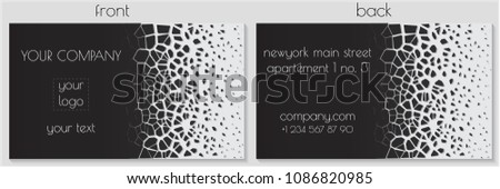 Stock Photo business card design with cracked and dissolving pieces efect