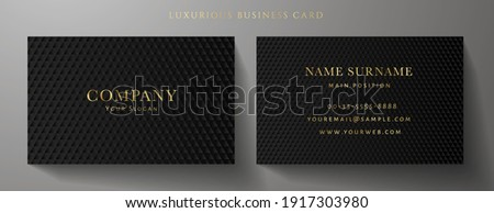 Business card with luxury abstract black triangle pattern (carbon texture). Formal premium background template useful for invitation design, Gift card, voucher or gift coupon, VIP invite