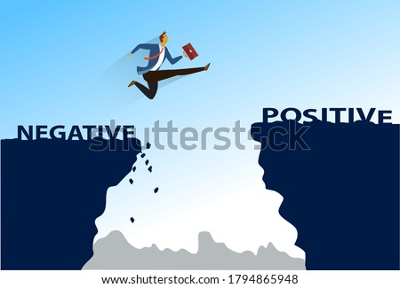 Business Concept As A Businessman Is Highly Jumping Up From Negativity To Positivity. businessman jumps over the ravine. Challenge, obstacle, optimism, determination in business concept
