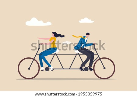 Business conflict, controversy or disagreement causing problem and failure concept, businessman and businesswoman colleagues or working team trying hard riding bicycle in opposite direction. Photo stock ©