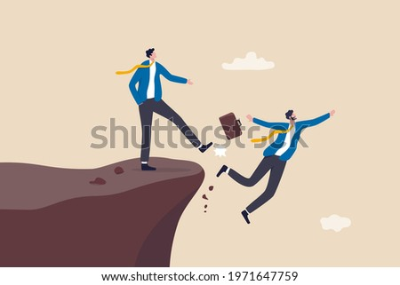 Business dishonesty, betrayal or jealousy colleague, career competitor or cheating concept, businessman kick business partner fall off the cliff. Сток-фото ©