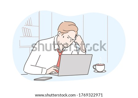 Business, frustration, mental stress, depression, work concept. Young depressed stressful frustrated businessman clerk manager working at office uses laptop. Overwork and negative emotions or headache