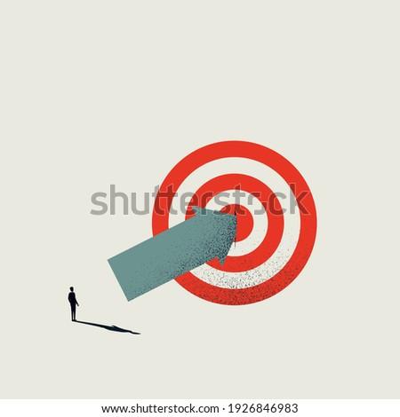 Business hit target vector concept with businessman hitting bullseye. Symbol of success, achievement. Eps10 illustration. Stock photo ©