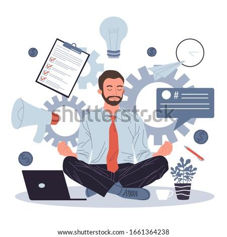 business man meditating and