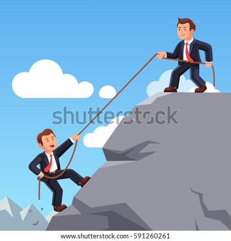 business man on top of mountain