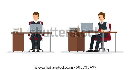 Business man sitting at his desk and working on laptop