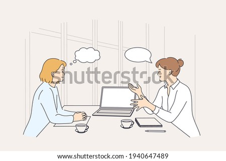 Business meeting, discussion, brainstorm concept. Two smiling businesswomen colleagues partners cartoon characters having meeting using laptop in office discussing strategy vector illustration  Foto stock ©