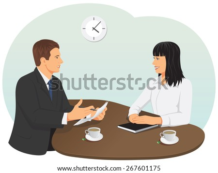 Business meeting in the office. Businessman and businesswoman are talking.