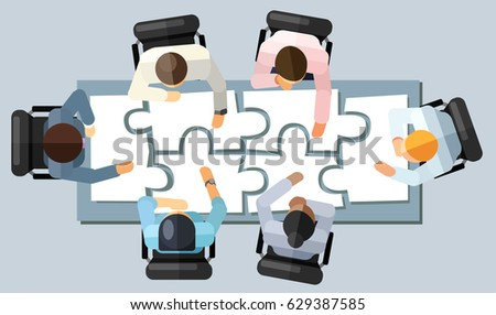 Business meeting strategy brainstorming concept. Vector illustration in an aerial view with people sitting in an office around a conference table solving a puzzle