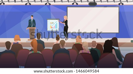 business people couple tribune speech. business people making financial presentation on conference meeting with flip chart. modern boardroom interior flat horizontal.