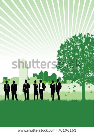 business people on a meadow with a cityscape background