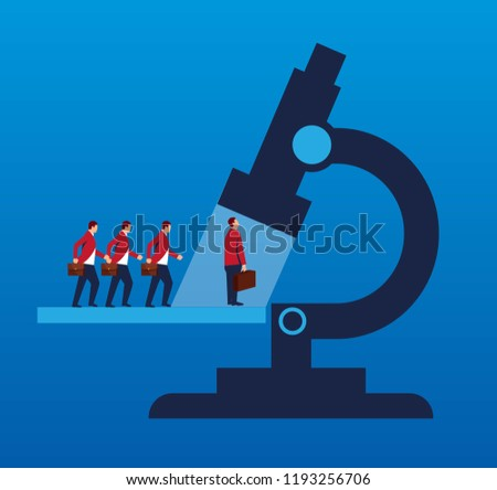 Business people standing in line under the microscope