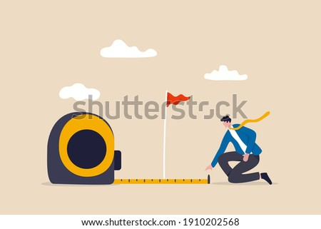 Business success measurement, how far from business goal and achievement or growth metric analysis concept, smart businessman using measuring tape to measure and analyze distance from target flag. Stock photo ©
