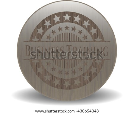 Business Training badge with wooden background