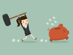 business woman try to brake piggy bank