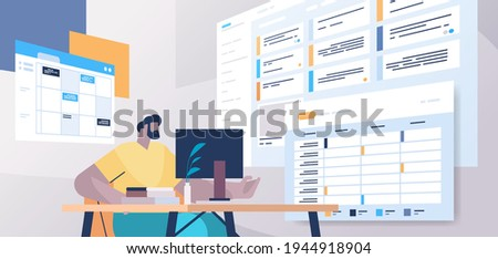 businessman at workplace planning day scheduling appointment in online calendar app agenda meeting plan
