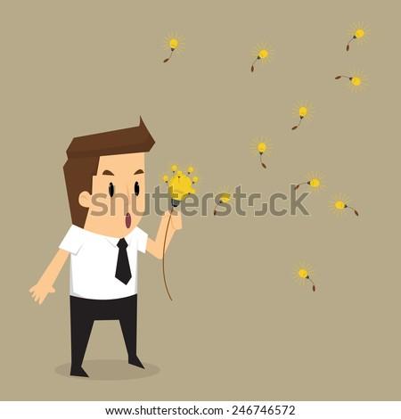 businessman blow bulb idea