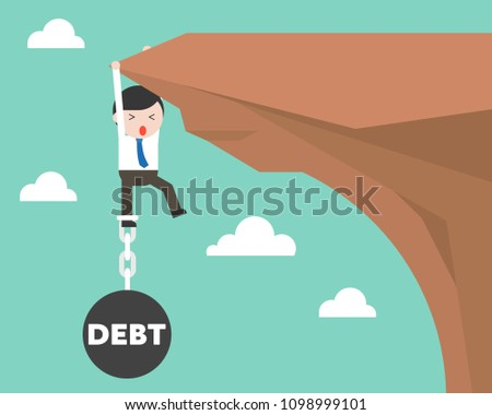 Businessman chained with Debt iron ball hanging on cliff