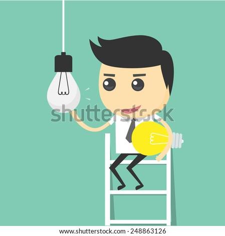 businessman change light bulb