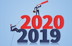 Businessman climbing numbers 2020 and looking to the future