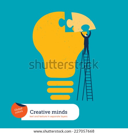 businessman completing a bulb