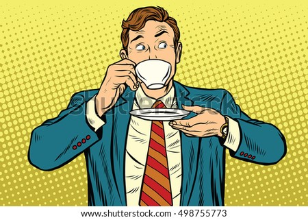 businessman drinking cup of...