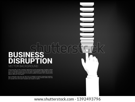businessman hand pushing the block to create domino effect to hit the goal. business concept of making the domino effect to make disruption.