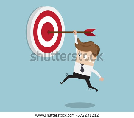 businessman hanging arrow on...