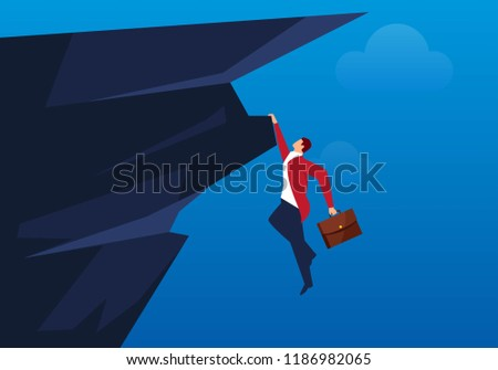 Businessman hanging on a cliff Stock photo ©