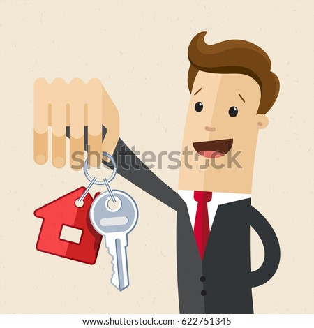 businessman hold a key of house