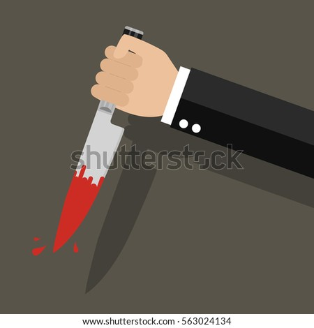 businessman holding a knife in