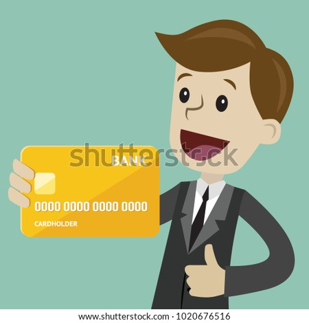 Businessman holds credit card in his hand and has profit. Succsessful business. Payments
