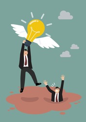 Businessman holds flying light bulb to get away from quicksand. Business concept