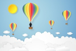 Businessman in the colorful hot air balloon as paper art, craft style and business new year start up concept. vector illustration.