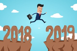 Businessman jump between 2018 and 2019 years through on the gap of hill colorful sky. happy new year 2019. Concept of transition between 2018 and 2019