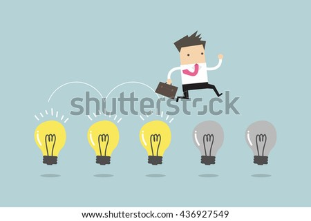 businessman jump on light bulbs
