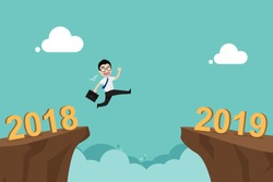 Businessman jump over cliff gap from 2018 to new year 2019. Concept for success and future goal in business. New year change