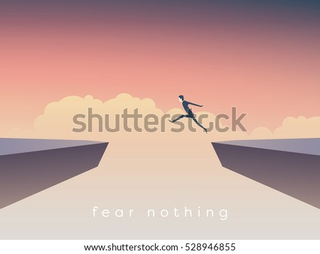 businessman jumping over chasm