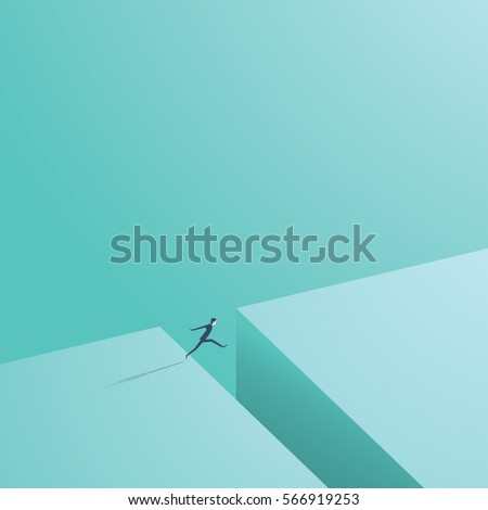 businessman jumping over gap as