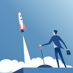 businessman launches rocket into the sky, employee performs the start-up of the spacecraft. Business startup concept