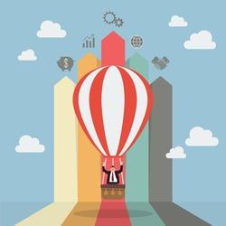 Businessman on hot air balloon with arrow bar chart. Business concept