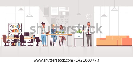 businessman presenting financial graph on flip chart to businesspeople team at conference meeting training presentation concept modern co-working space office interior full length horizontal Photo stock ©