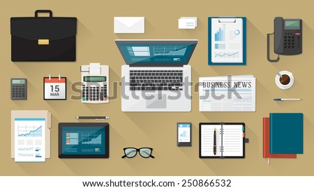 Businessman\'s desk with laptop, tablet smartphone and stationery