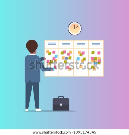 businessman scheduling his work agenda weekly meeting schedule task board with sticky notes business planning news events reminder and timetable concept rear view full length flat