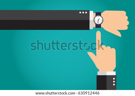 businessman showing time on his