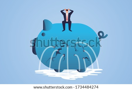 Businessman sitting on a leaky piggy bank