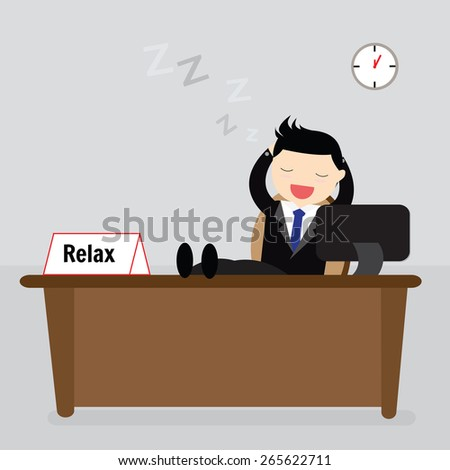 Businessman sitting relaxed with his feet on the desk and hands behind the head