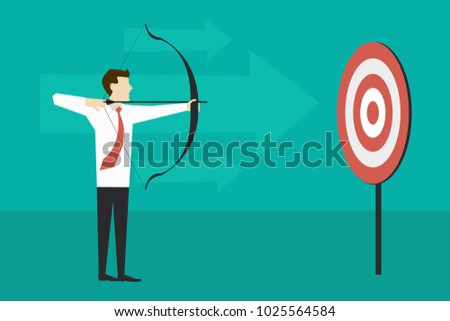 businessman standing and aiming