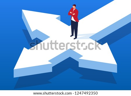 Businessman standing at the crossroads