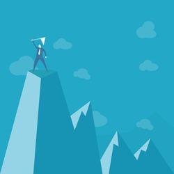 businessman standing on peak mountain